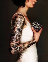 black ink roses tattoo on women right full arm