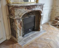 antique louis xiv style fireplace made of pink and red veined