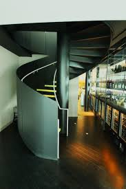 Under Stair Bar by Contemporary Commercial Bar Interior Under Modern Metal Spiral
