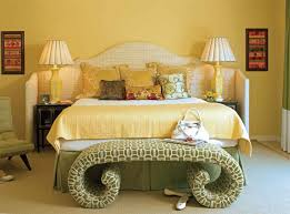 Yellow Bedroom Walls Yellow Bedroom Colours With Carved Wall Decor And Brown Curtains
