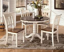 two tone cottage round table and 4 side chairs by signature design two tone cottage round table and 4 side chairs 5 piece