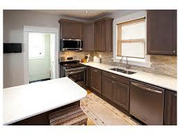 midcentury kitchen peninsula dark floor two tone cabinets tile