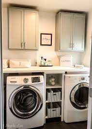 how should painted cabinets last adding inexpensive painted cabinets in our laundry room 11