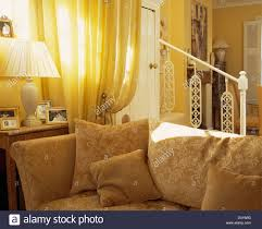Pale Yellow Living Room by Pale Yellow Door Curtain Beside Beige Patterned Sofa With Matching