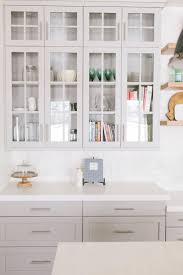 best 25 grey cabinets ideas on pinterest gray kitchen cabinets stunning kitchen features glass front upper cabinets and light gray lower cabinets painted benjamin moore mindful gray paired with caesarstone organic white