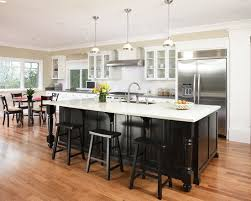 white kitchen cabinets with black island white kitchen cabinets black island black stools subway tiles
