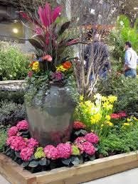 pots in gardens ideas annual flowers in pots large urn filled with colorful plants at