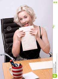 office worker at desk licking an envelope stock photo image