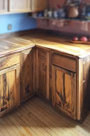 custom live edge oak with rustic front facing kitchen cabinets by