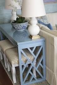 Table With Ottoman Underneath by How To Decorate With Pouf Ottomans Under Console Table Pillows