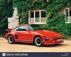 porsche driveway transport motor vehicle 1980s porsche 911 german sports car in