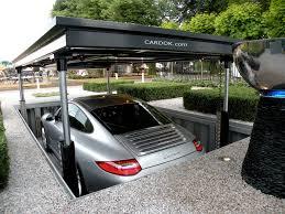 pop up garage stows your car safely underground we interrupt