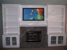 Fireplaces With Bookshelves by Picture Of Cabinets And Arched Bookcases Built Around A Fireplace