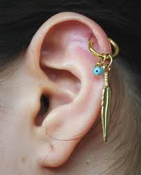 cartilage earrings ways to express your individuality with a cartilage piercing