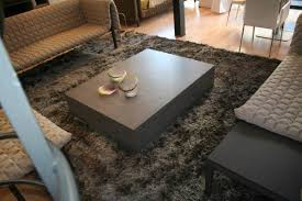 contemporary coffee table concrete rectangular on casters