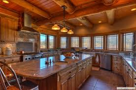 wrap around log home kitchen with large island view i absolutely