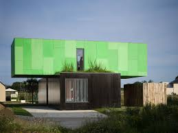 nice green nuance of the modern prefab log cabins that can be