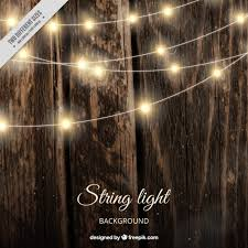 realistic wooden background with string lights vector free
