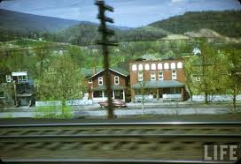 color photographs of the usa in 1950 through window of a train
