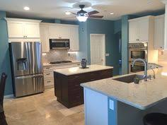 Merit Kitchen Cabinets Merit Kitchen Painted High Gloss Cabinets In White And Tangerine