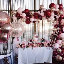 a set up of gold burgundy and baby pink balloon