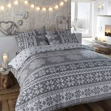 duvet cover in grey winter bedding in a warm flannelette quilt cover set with nordic snowflake designs in white