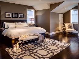 contemporary master bedroom with specialty door u0026 hardwood floors