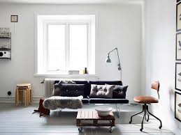 living room gray sofa and white shelves with brown chairs plus