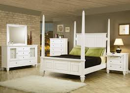 white polished wooden king size canopy bed with 4 poles and high