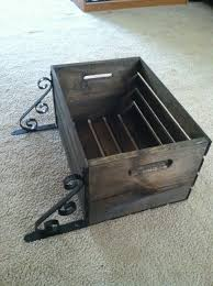 wooden crate from walmart stain it add brackets from lowes hang