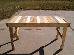 diy pallet work table wood pallet work table i use mine for my garage as i didn t have