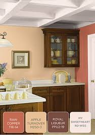 behr paint in cheerful tangerine makes the base for this colorful