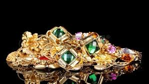 various gold jewellery on black background stock photo picture