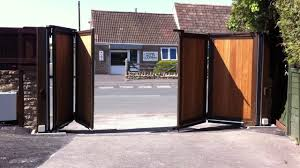 automated wooden infill bi folding gates the electric gate