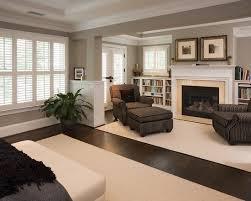 master bedroom sitting room light trim and wainscoting with rich darker tones in furniture and a