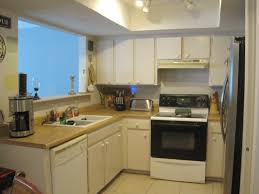 U Shaped Kitchen Designs With Breakfast Bar by Blue Design Accent Color On Cabinets Round Recessed Ceiling Lamp