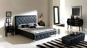 luxury black bedroom design with white floral bed sheet and cool
