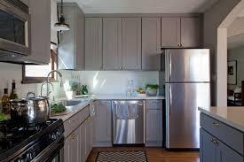 wood countertops light grey kitchen cabinets lighting flooring