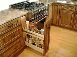 hidden rack in a wooden custom kitchen cabinet with granite