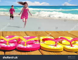 kids running towards colorful flip flop stock photo 14375329