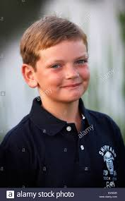 a 10 year boy with brown hair stock photo royalty free