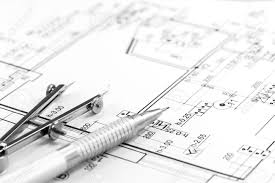 drawing compass and pencil on house floorplan stock photo picture