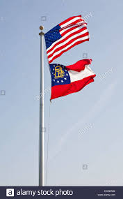 Georgia Flag State American Flag Flies Above The Flag Of The State Of Georgia Usa