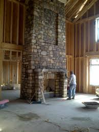 living room interior fireplace stacked stone modern stone