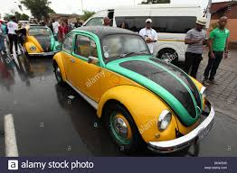yellow volkswagen beetle royalty free soweto south africa 8th dec 2013 two vw beetle cars painted in