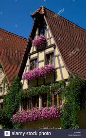 old historic building with flower window boxes in rothenburg ob