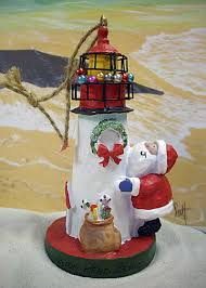island ornament santa hugging lighthouse