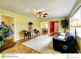 Yellow Living Room Rugs Bright Living Room With Yellow And Red Walls Stock Photo Image