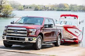 ford truck red ford and gm add high tech towing aide packages to new trucks