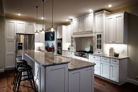 modern kitchen with cabinetry with grey granite countertop also